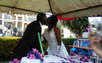 A couple beginning their marriage with a kiss