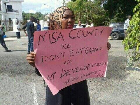 A woman protests outside Coast regional headquarters as Joho records statement